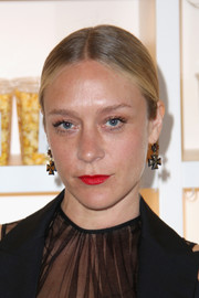 Chloe Sevigny went old school with this center-parted bun for the screening of 'The Realest Real.'