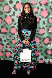 Rosario Dawson kept it understated up top in a black silk button-down during the Kenzo x H&M launch.