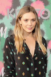 Elizabeth Olsen wore her hair loose with barely-there waves when she attended the Kenzo x H&M launch.