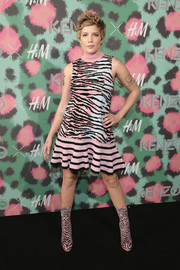 Halsey matched her dress with a pair of zebra-print mid-calf boots, also by Kenzo x H&M.