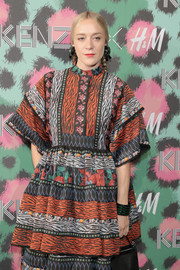 Chloe Sevigny paired a green and black cuff with a mixed-print dress, both by Kenzo x H&M, for the collaboration's launch event.