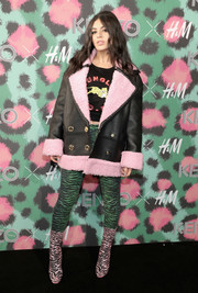 Charli XCX bundled up in a Kenzo x H&M pea coat, in black faux leather and pink shearling, for the collaboration's launch event.