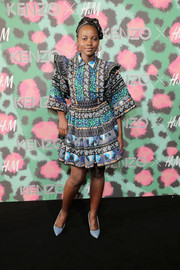 Lupita Nyong'o looked exuberant in a mixed-print mini dress by Kenzo x H&M during the collaboration's launch event.