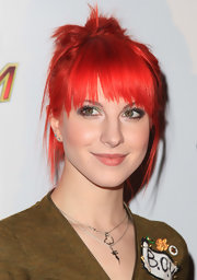 Hayley Williams blazed the red carpet at the Jingle Ball where she sported a fiery red updo.