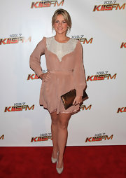 Ali paired a girlie blush dress with spot on nude platform pumps.