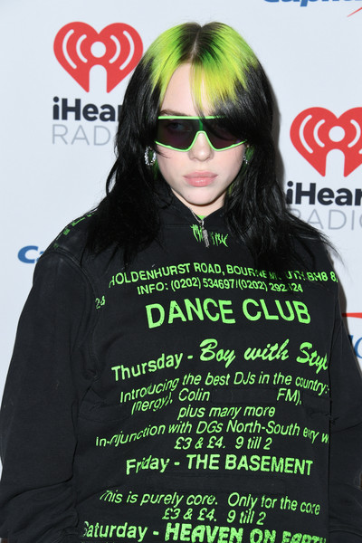 Billie Eilish went sporty with these shield sunglasses by Prada during KIIS FM's Jingle Ball 2019.