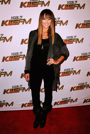 Sharni wore black leather boots with large cuffs for her rocker ensemble at the Wango Tango concert.