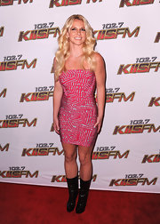 Britney Spears toughened her sultry mini dress with black patent mid-calf boot.