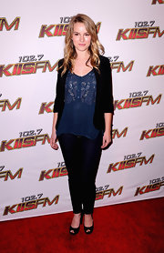 Bridgit threw on a classy black jacket over a sheer blue embroidered blouse for a totally polished look.