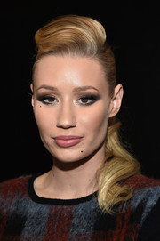 Iggy Azalea turned heads with her perfectly sculpted pompadour ponytail during Kiss 108's Jingle Ball.