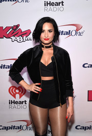 Demi Lovato's red mani totally popped against her black outfit.