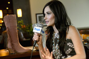 Kacey Musgraves wore an eye-catching turquoise necklace at the Kacey for Lucchese collection launch.