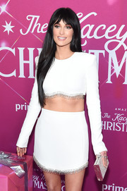 Kacey Musgraves looked festive sporting this metallic Judith Lieber clutch with her fringed outfit at the screening of 'The Kacey Musgraves Christmas Show.'
