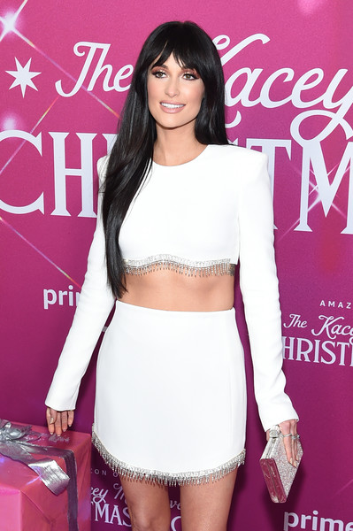 Kacey Musgraves Metallic Clutch [kacey musgraves christmas show,clothing,shoulder,crop top,beauty,fashion,leg,fashion model,waist,thigh,joint,kacey musgraves,screening,new york,metrograph,screening]