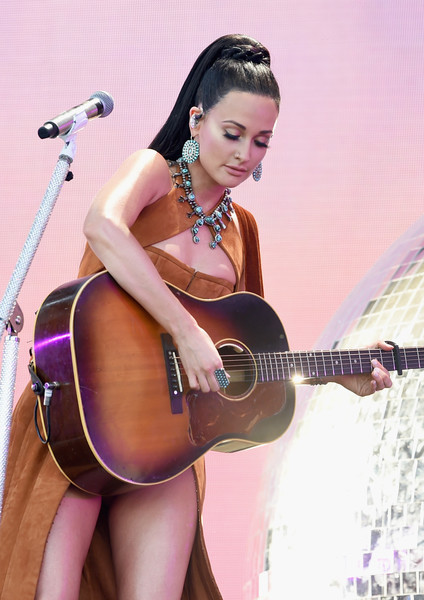 Kacey Musgraves Statement Ring [string instrument,musical instrument,guitar,acoustic guitar,plucked string instruments,musician,music,singing,performance,kacey musgraves,coachella valley music and arts festival,coachella stage,indio,california]