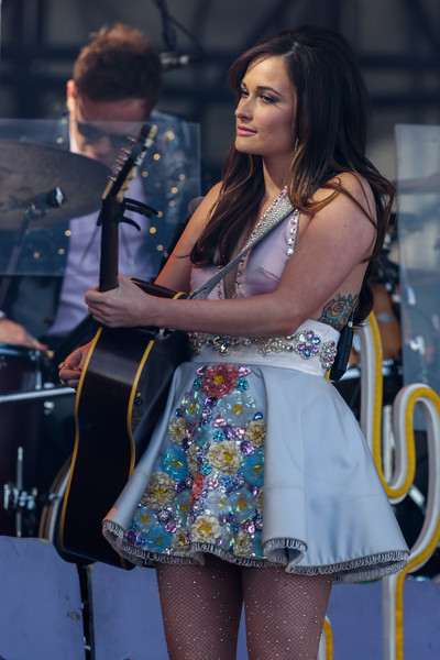 Kacey Musgraves Halter Dress [thigh,fashion,leg,performance,beauty,human leg,yellow,singing,street fashion,musician,kacey musgraves,indianapolis,indiana,white river state park,ncaa,march madness music festival,ncaa march madness music festival,capital one jamfest]