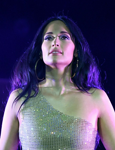 Kacey Musgraves Teased [world: tour ii,purple,green,beauty,lady,performance,violet,fashion,lip,fun,black hair,kacey musgraves,kacey musgraves in concert,leg,las vegas,nv,cosmopolitan of las vegas,the chelsea]