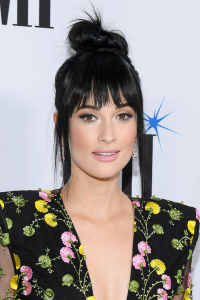Kacey Musgraves Hair Knot [hair,hairstyle,black hair,bangs,beauty,chin,forehead,lip,long hair,eyelash,arrivals,kacey musgravesattends,bmi country awards,nashville,tennessee,bmi]