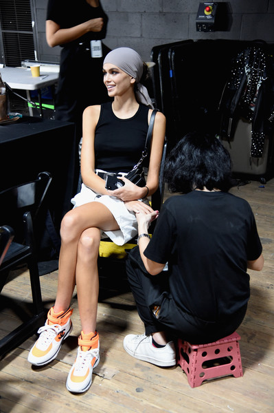 Kaia Gerber Basketball Sneakers [fashion,yellow,footwear,street fashion,shoe,automotive design,sitting,leg,photography,fashion design,tom ford,kaia gerber,tom ford - backstage,new york city,park avenue armory,new york fashion week,fashion show]