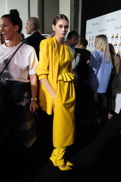 Kaia Gerber Leather Dress [image,yellow,fashion,outerwear,costume,event,fashion design,uniform,shaolin kung fu,max mara - backstage,kaia gerber,filters,milan,italy,max mara,milan fashion week,show,milan fashion week spring]