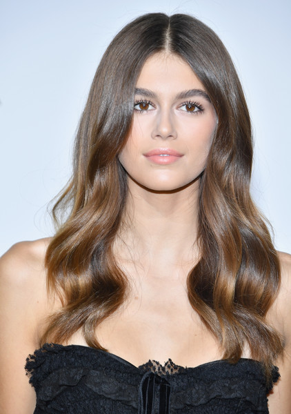 Kaia Gerber Long Wavy Cut [hair,face,hairstyle,long hair,brown hair,beauty,hair coloring,layered hair,eyebrow,lip,kaia gerber,her time,omega photocall,part,paris,france,paris fashion week womenswear spring]