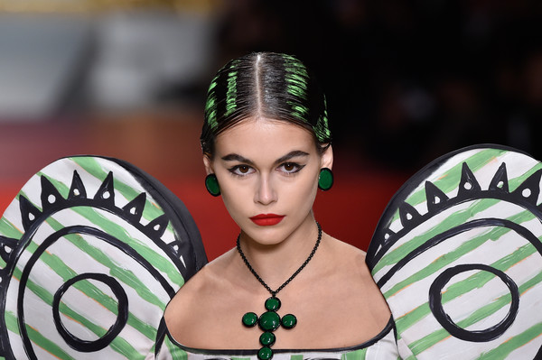 Kaia Gerber Cross Pendant [hair,face,green,beauty,fashion,forehead,lip,black hair,cool,muscle,kaia gerber,moschino - runway,runway,milan,italy,moschino,milan fashion week,show,milan fashion week spring]