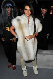 Kim Kardashian got all glammed up with a lavish fur stole for Kanye's fashion show.