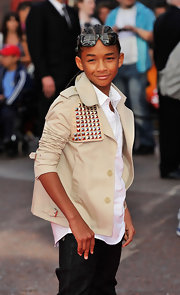 Jaden is a stud in a studded cropped trench jacket.