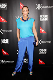 Charlotte Dawson opted for a color-blocked look in a silky turquoise top tucked into loose cobalt slacks.