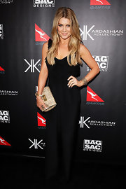 Natalie Bassingthwaighte wore a black evening dress with ruffled shoulders for the Kardashian Kollection Handbag launch.