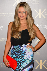 A red patent leather clutch finished off Emily Atack's look with a shock of color during the Kardashian Kollection for Lipsy launch.