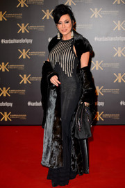 Nancy Dell'Olio layered a black velvet opera coat over an evening dress for a dramatic red carpet look during the Kardashian Kollection for Lipsy launch.