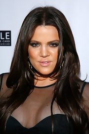 Khloe Kardashian rocked an updated smoky eye for the fall season by opting for a smoldering brown hue. She completed her look with nude lip gloss.