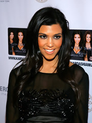 Like her sisters, Kourtney is a big proponent of major false eyelashes.