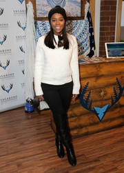 Aja Naomi King was cozy and cute in a multitextured white sweater while visiting Kari Feinstein's Style Lounge.