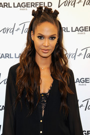 Joan Smalls looked oh-so-cool wearing this long wavy hairstyle with multiple knots at the top during the Karl Lagerfeld Paris x Elle event at the Lord & Taylor flagship.