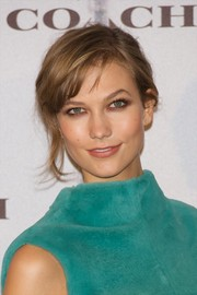 Karlie Kloss kept it simple with this slightly messy updo when she attended the Coach boutique opening.