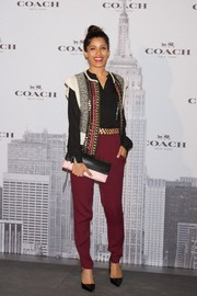 Freida Pinto completed her ensemble with a pink and black Coach leather clutch.