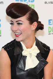 Amy Heidemann wore her sleek chestnut tresses in a retro-inspired updo while visiting the Z100 Elvis Duran morning show.