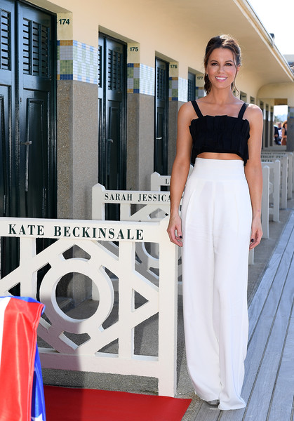 Kate Beckinsale Wide Leg Pants [clothing,white,shoulder,dress,fashion,haute couture,waist,street fashion,fashion design,formal wear,kate beckinsale,photocall - 44th,deauville talent award,deauville,france,deauville american film festival,photocall]