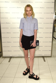Kate Bosworth proudly showed off a pair of chunky black platform sandals from her Matisse collection.