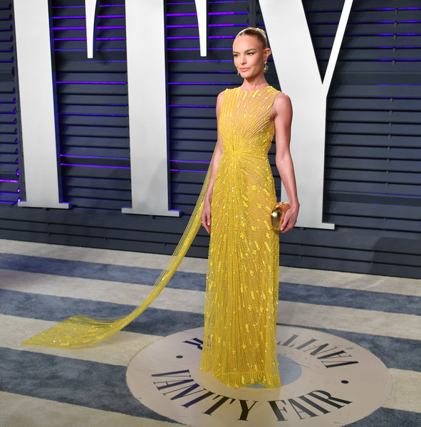 Kate Bosworth Metallic Clutch [oscar party,vanity fair,clothing,dress,shoulder,yellow,fashion,haute couture,fashion model,gown,formal wear,joint,beverly hills,california,wallis annenberg center for the performing arts,radhika jones - arrivals,radhika jones,kate bosworth]