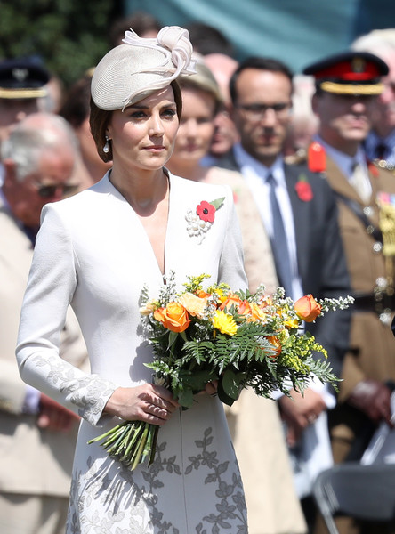 Kate Middleton Decorative Hat [the royal family attend the passchendaele commemorations,white,facial expression,lady,ceremony,event,tradition,flower arranging,smile,floral design,headgear,members,commemorations,catherine,duchess,flowers,centenary,belgium,commonwealth war graves commisions,ceremony]