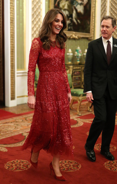 Kate Middleton Sequin Dress [carpet,red carpet,dress,clothing,red,formal wear,flooring,gown,fashion,suit,duke,host,harry,duchess,duchess of cambridge,uk,cambridge,buckingham palace,reception,africa investment summit,catherine duchess of cambridge,buckingham palace,kensington palace,wedding of prince william and catherine middleton,princess,duke,prince harry duke of sussex,sophie countess of wessex]