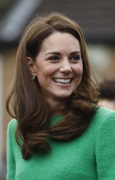 Kate Middleton Long Wavy Cut [hair,face,facial expression,hairstyle,smile,eyebrow,chin,beauty,blond,lady,visits schools in support of childrens mental health,duchess of cambridge,place2be,support,duchess,lavender primary school,cambridge,children\u00e2,catherine,patron]