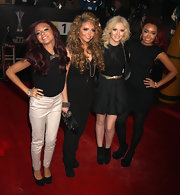 Jade Thirlwall went for a classic look, pairing chinos with a black blouse.