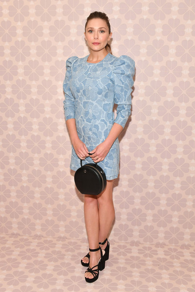 Elizabeth Olsen chose a pastel-blue floral dress with puffed sleeves for the Kate Spade Spring 2019 show.