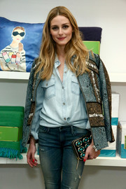 Olivia Palermo attended the Kate Spade New York Housewarming event carrying a stylish beaded clutch from the label.