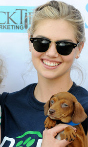 Kate Upton accessorized with a pair of Ray-Ban Clubmaster sunglasses at the Grand Slam Adoption event.