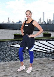 Kate Upton was casual and sporty in a black tank top at the Strong4Me workout event.